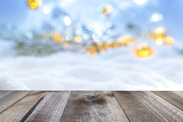 Winter christmas background with wooden table and blur abstract