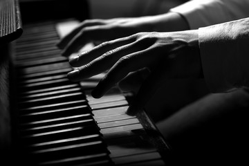 Hands of pianist in black and white