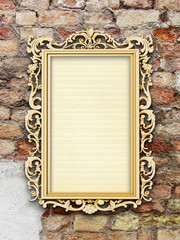 Single blank golden Baroque picture frames on weathered brick wall background