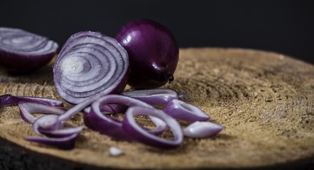 Red onion on wooden rustic backround