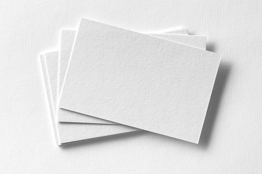 Corporate stationery set mockup at white textured paper background.