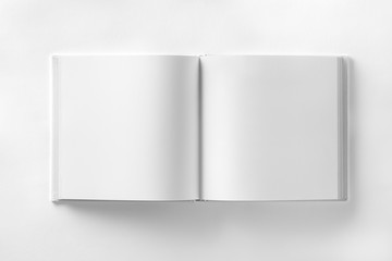 Mockup of opened blank square catalogue at white paper bacground