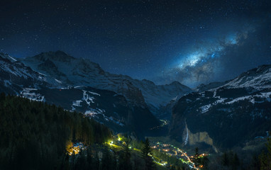 Milky way over fairytale-like Lauterbrunnental and the snowy Jungfrau, Bernese Oberland, Switzerland