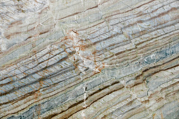 Intense stone texture, oblique pattern red brown gray stripes