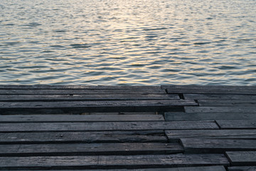 Sunlight reflection in lake with wood floor