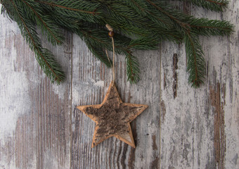 Christmas decoration, star, and conifer of fir tree on textured