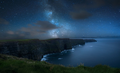 Milky way over dramatic Cliffs of Moher and wild Atlantic Ocean, Ireland