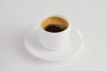 Closeup image of hot cup of espresso coffee isolated