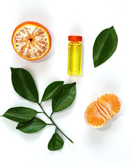 Serum with Vitamin C, tangerine and mandarin leaves isolated on white background 3