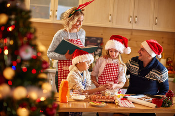 Family with children preparing cookies for Xmas.