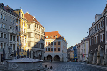 Historic buildings in bright colors at medieval Untermarkt (lower market) with Neptune fountain in Goerlitz, Germany.