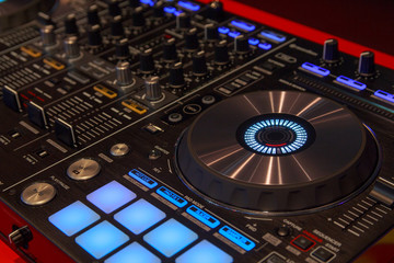 DJ player and mixer in nightclub. Music