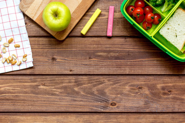 ingredients for children's lunch on wooden background top view