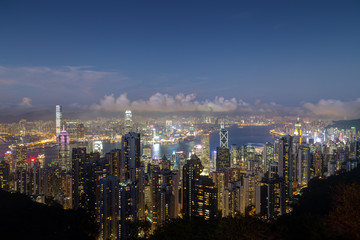 Hong Kong's famous skyline viewed from the Victoria Peak in the evening. Copy space.