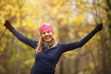 Girl doing exercises in forest