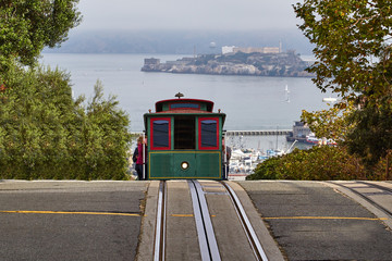 A cable car cresting a hill in San Francisco
