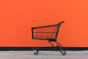 Minimalism style, Shopping cart and orange wall.