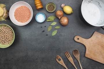 Top view on food ingredients and cooking accessories. Flat lay food background.