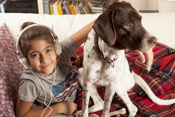 kid listenning music with pet