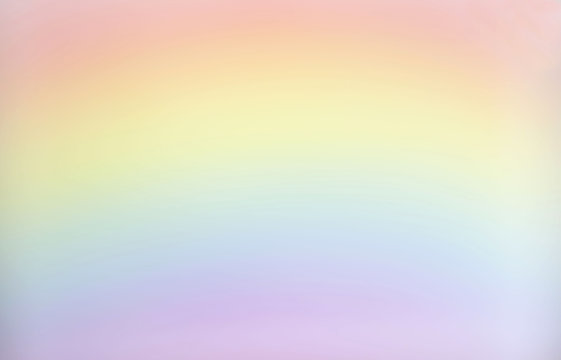 horizontal blank background image of pastel red and yellow and blue and pink rainbow great for copy or text space  and great for greeting cards.