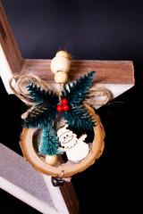 Ghirlanda di legno su stella di Natale