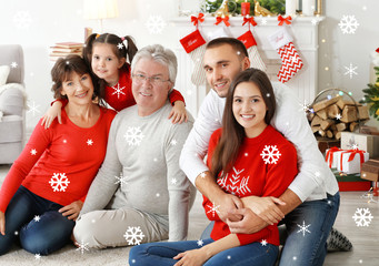 Happy family at room decorated for Christmas. Christmas celebration concept. Snowy effect.