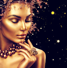 Beauty fashion model girl with golden makeup, hair style isolated on black background