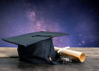 graduation cap, hat with degree paper on wood table, milky way b