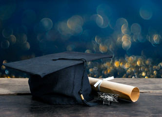 graduation cap, hat with degree paper on wood table, abstract li