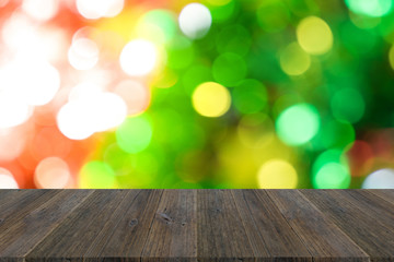 Abstract bokeh background of Christmas tree with wood terrace
