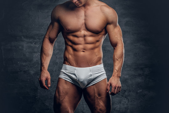 Athletic male body in white panties.