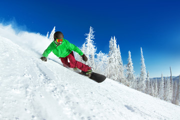 Active snowboarder snowboarding rides closeup