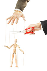 Man cuts threads of a wooden puppet. Concept of release and stopping manipulation
