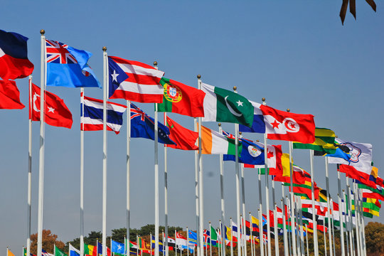 the flying flags of all nations in the wind / A view of the flying flags of all nations in the wind in Seoul Korea