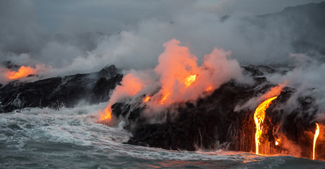 Molten lava flowing into the Pacific Ocean on Big Island of Hawa