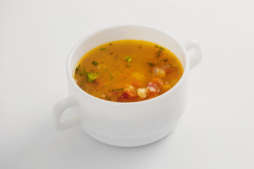 Bowl of fresh vegetable soup isolated at white background.