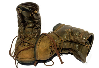 A pair of old, leather mountaineering boots