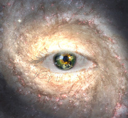 Eye in midst of Galaxy with Earth Reflection  Some elements provided courtesy of NASA