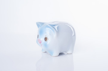 blue piggy bank on white background. concept saving finance and investment.