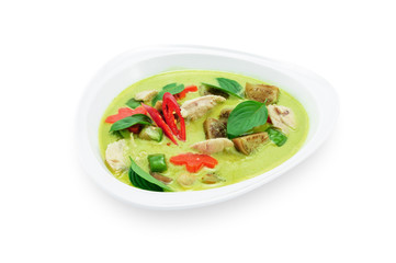 Green curry with chicken in white plate isolated