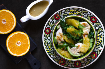 Salad with arugula avocado orange chicken and honey dressing