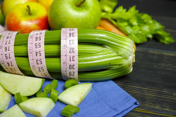 Green vegetables and fruits -  celery shoots and  apples, dietary fitness concept