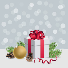 Christmas gift box with red ribbon and decoration ball on silver
