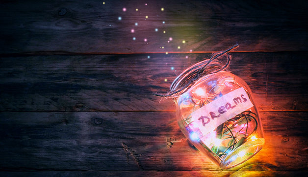 garlands of colored lights in glass jar with dreams