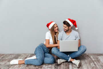Photo of christmas couple with laptop