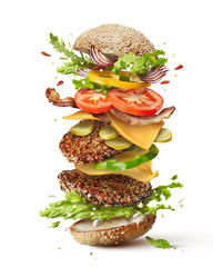 Fototapeta burger with flying ingredients obraz