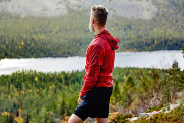 Hiker enjoying view on steep hill, Kesankitunturi, Lapland, Finland