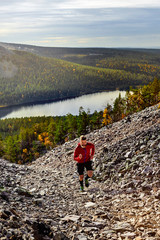 Man running in mountains in fall