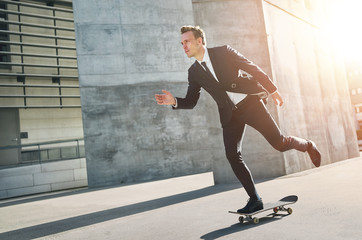 Extremal man wearing suits rides a skateboard