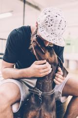 Man cuddling with his dog